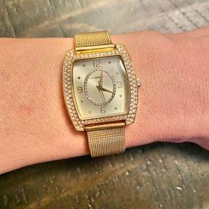 Isaac Mizrahi gold tone watch with rhinestones